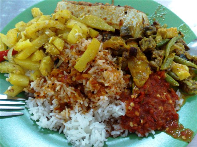 Nasi Padang of Assam Stingray, stir fried potato strips and sambal goreng (unique curried version) This plate with extra rice is only $3.00... unheard of in the whole of Singapore...