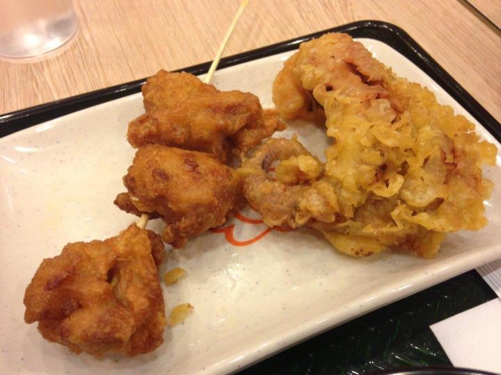 Fried chicken pieces (RMB8) and squid tentacles (RMB6).
