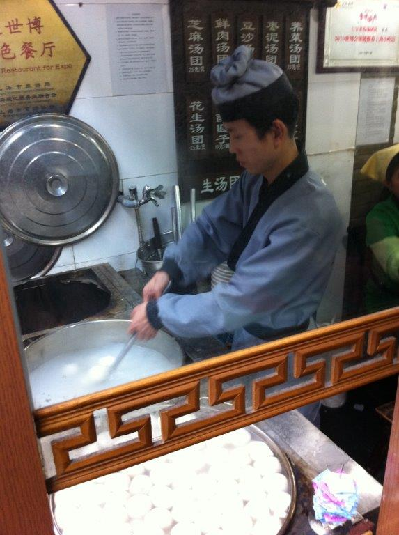 Guy cooking the balls in front... they differentiate the balls from the shapes...