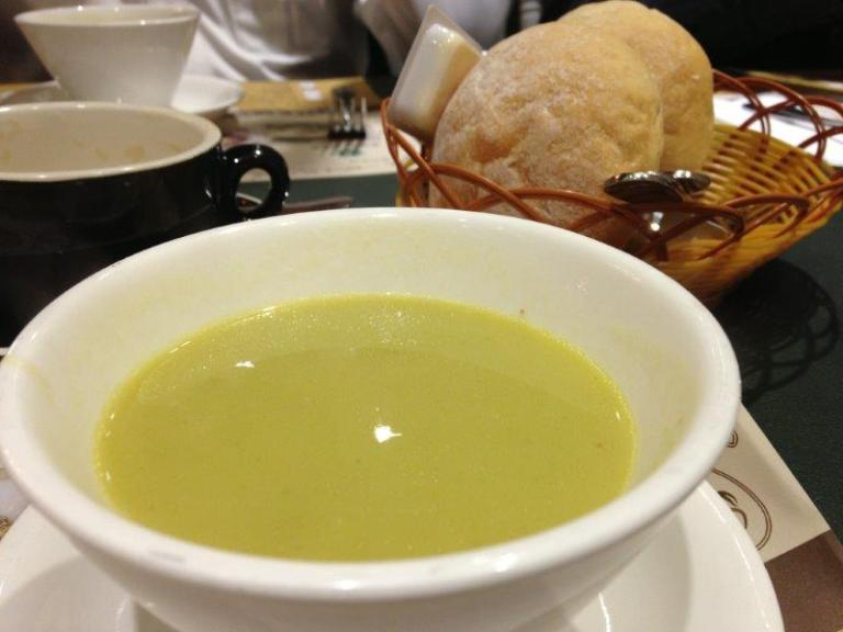 Asparagus soup that comes with hot buns as part of the set meal