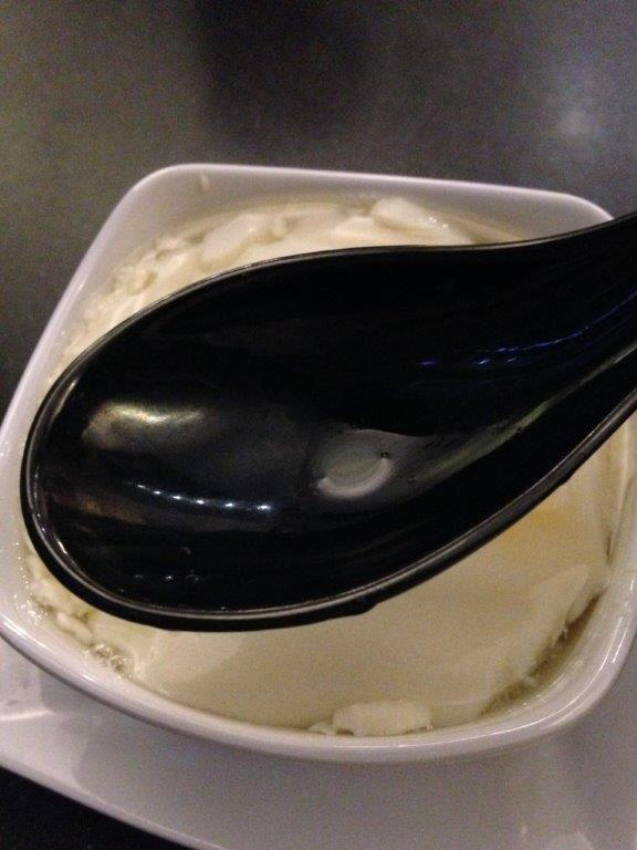 Unusually big spoon for the soy bean curd...