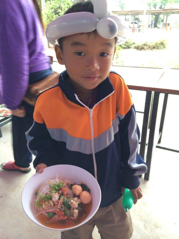 One of the kids collected his bowl and preparing to feast
