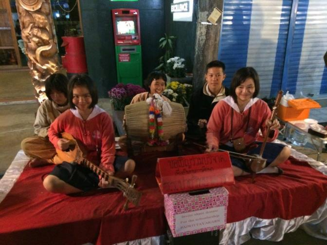 Children raising funds by performing