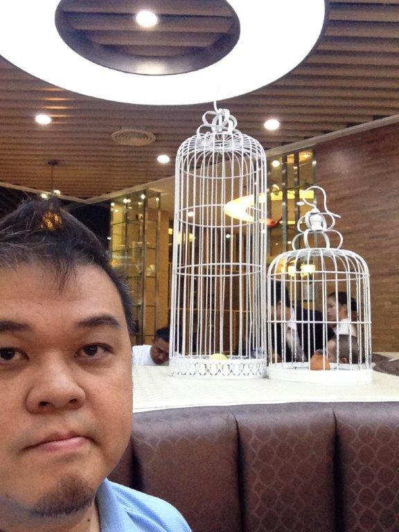 Selfie with the decor of bird cages