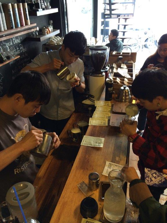 2 baristas rushing the multiple orders. Love this shot.