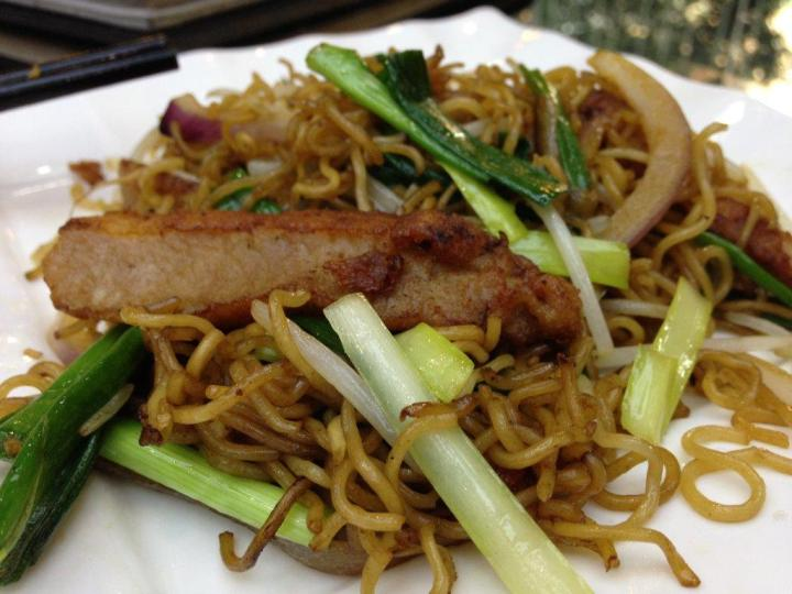 Fried Instant Noodles with Pork Chop - A standard entree in most HK cafes, this one is not bad.