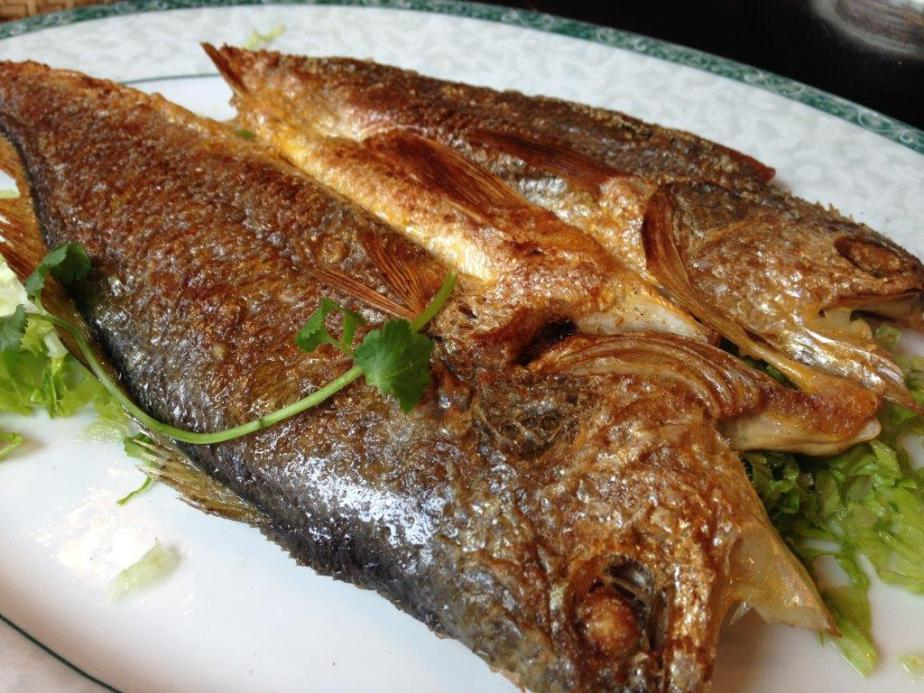 Pan fried yellow fish. Very nicely fried but a little salty.