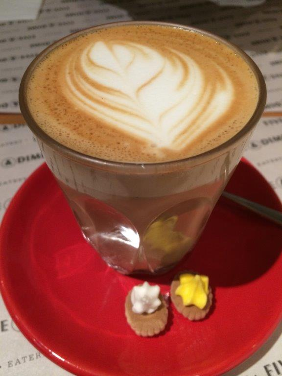 Piccolo Latte ($5) with 2 traditional candy biscuit