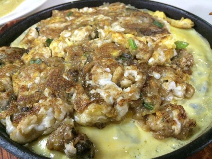 Fried Oyster Omelette $12 is served piping hot on a hot plate.