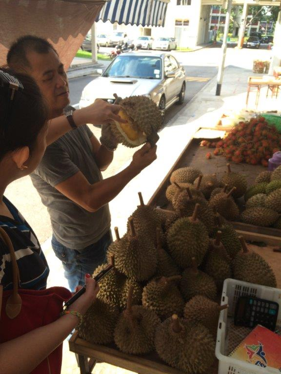 Boss showing friend the freshness of the durians
