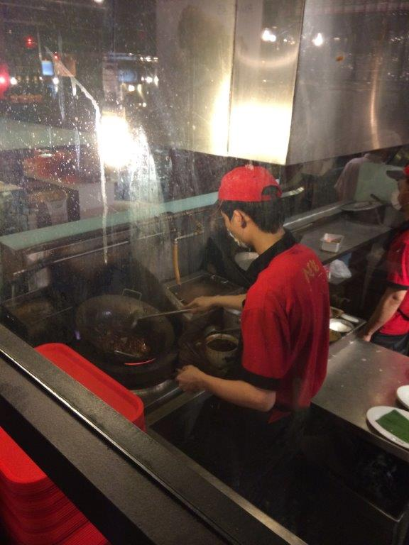 You can see the cook frying your noodles and they fry plate by plate to ensure consistent quality.