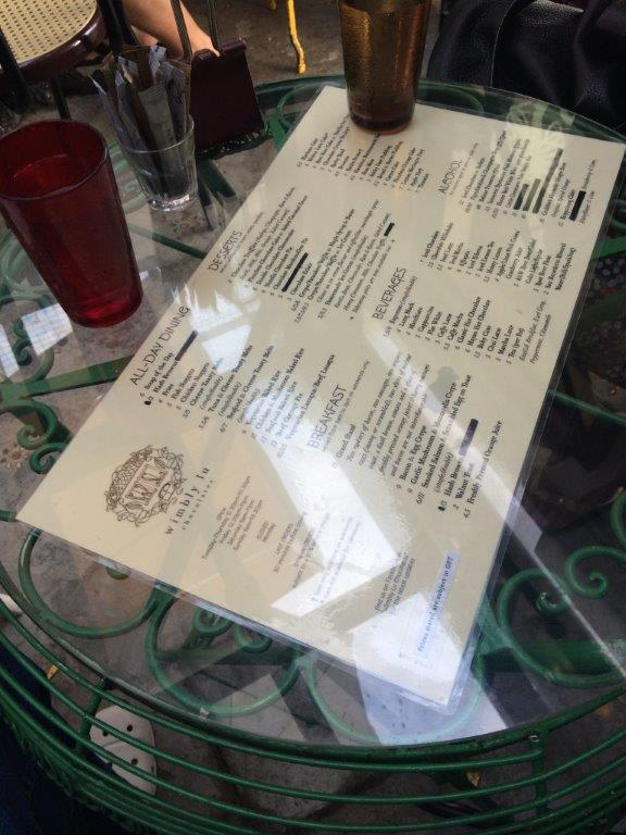 Menu under the glass table top.