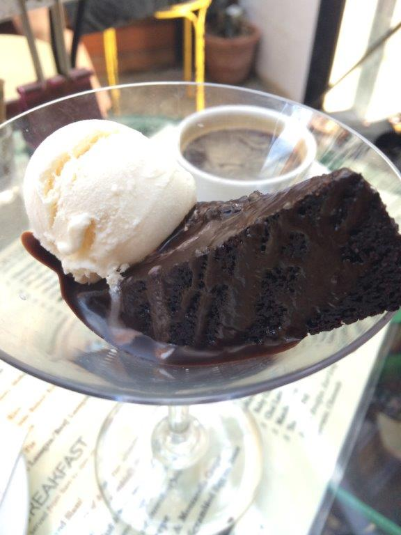 So I ordered. Came with a scoop of vanilla ice cream. The cake tasted like a root beer brownie. Very interesting and goes well with the ice cream.