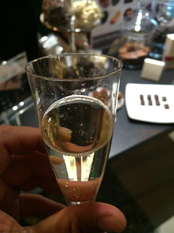 I was served a glass of Moscata first before tasting the chocolates. Moscato wines are sparkling sort and extremely fruity, light (Usually less than 8% alcohol) and sweet. Great pairing with the white and milk chocolates.