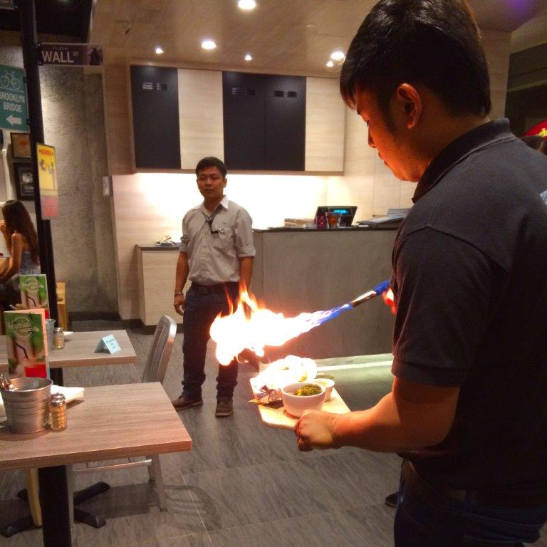Serving staff preparing the next entree... Yes, real flames! A twist to conventional baked rice!