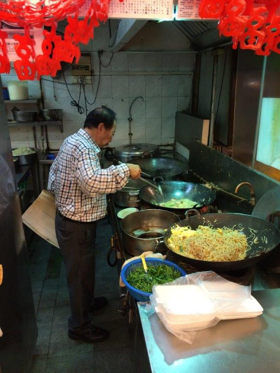 Mr Tan frying the mee personally
