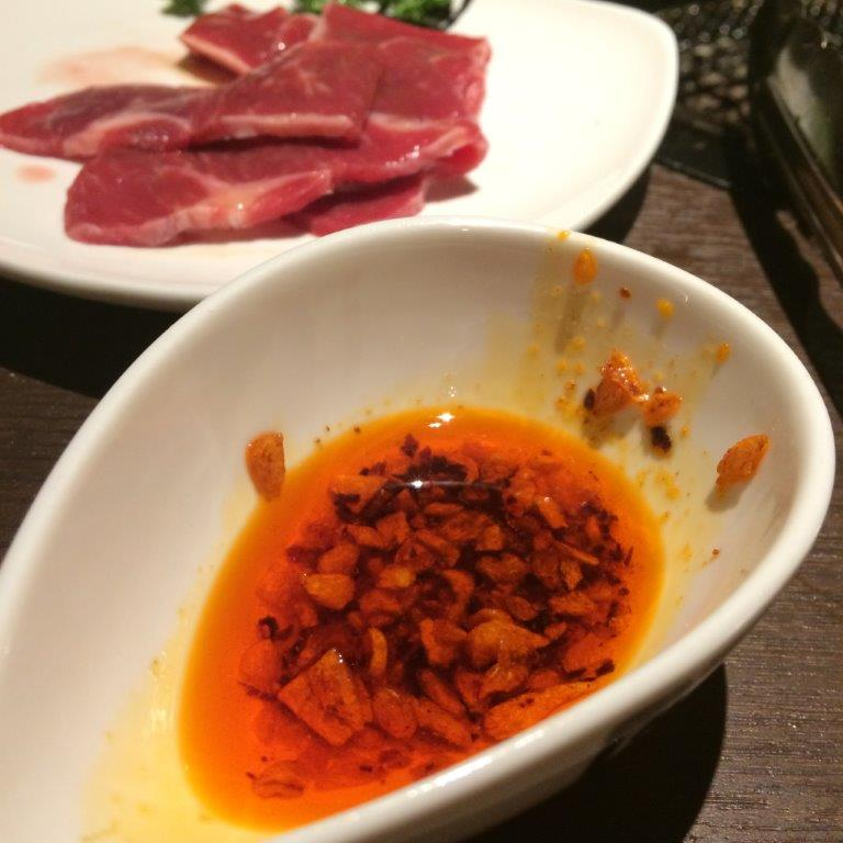 the chilli oil with very aromatic crispy garlic inside. Not spicy at all though.