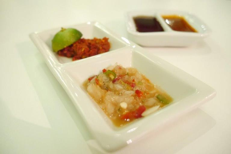 Cnodiments of sambal chilli and cinchalok to make your food tastier.