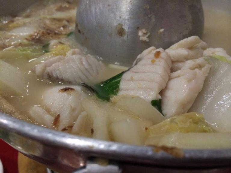 Yummy yummy fish slices closed up. This soup is the typical teochew style where they use sour plum inside and loads of bones to boil the soup for hours.