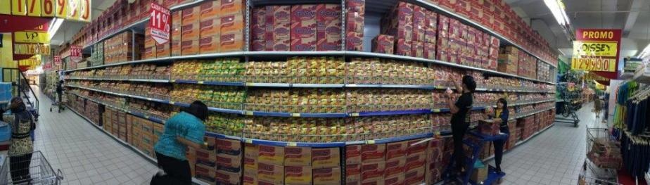 See this pano shot of the whole row of Indomie instant noodles.