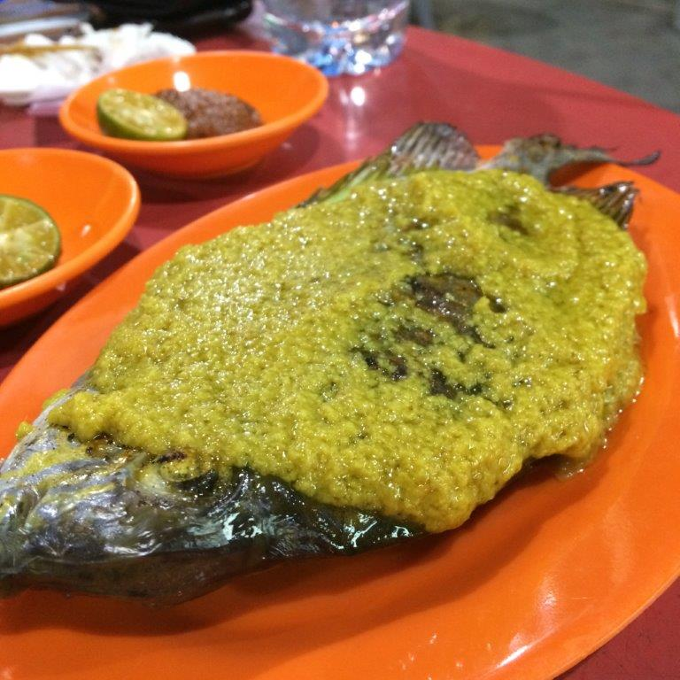 Ikan Lebam 31000 ($3.10) Notice the sauce they use is different from ours. Minced ginger with tumeric, Yums!