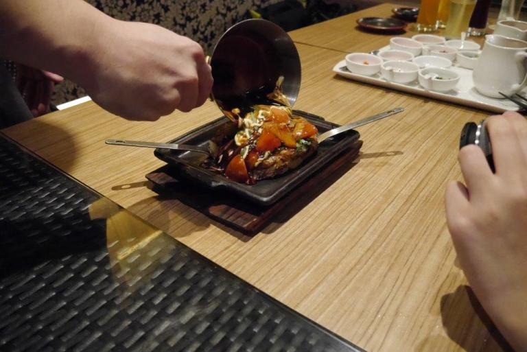 In comes the Tomato Okonomiyaki. Sizzling and cooked in front of us by the head chef.