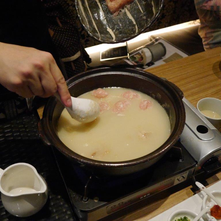 As part of the Mizutaki experience, the server will skillfully roll minced chicken into balls to be dropped into the soup, together with cabbage, mushroom and tofu.