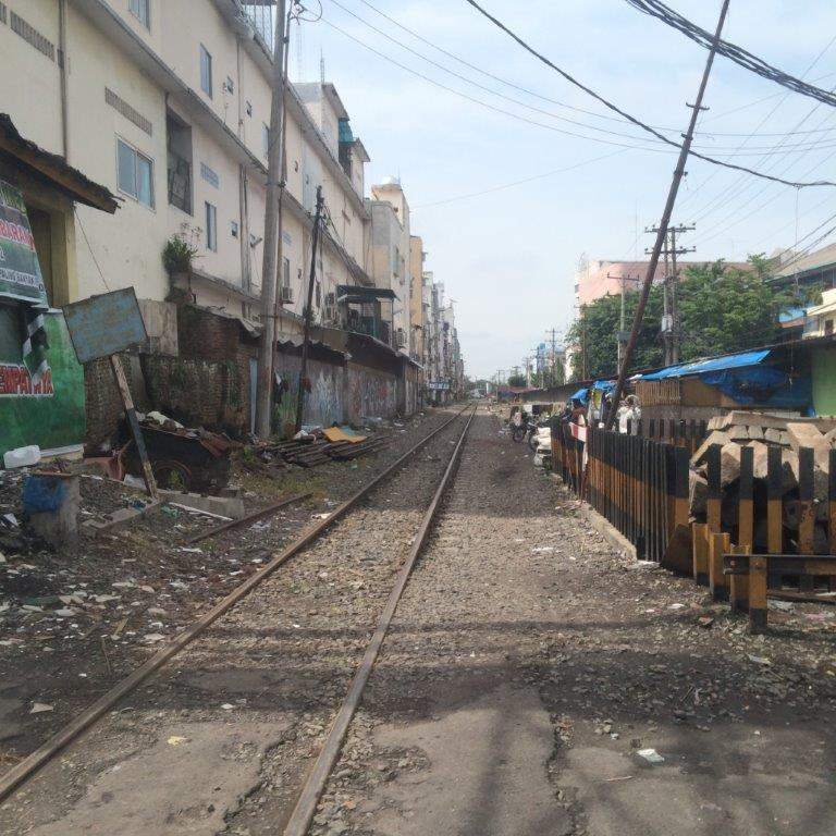 Railway tracks run through the back of some housing... Reminds me of a lot of places... Thailand, India, etc...