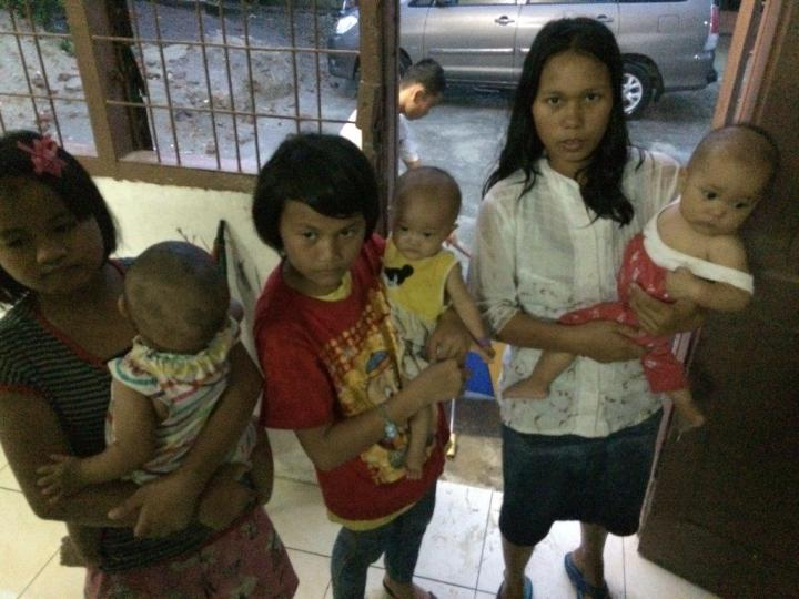 All the young ones the older orphans help to take care.