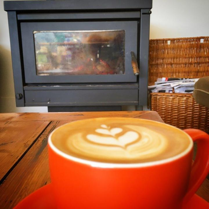 Coffee by the fireplace is just so warm at heart