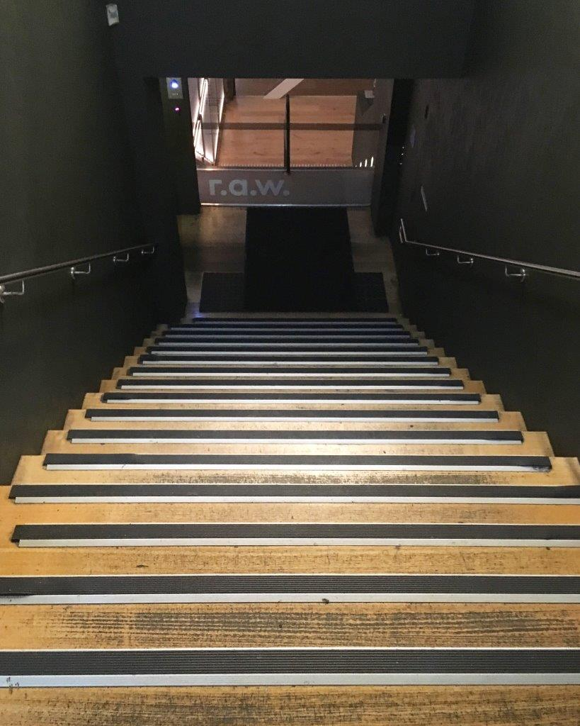 First flight of stairs downwards is a yoga studio